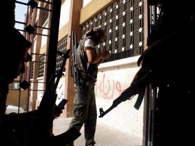 Syrische Rebellen in einer Kampfpause. Foto: epa/stringer