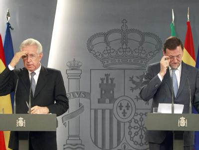 Ratlos ob der  Äußerungen von EZB-Präsident Mario Draghi: Die Ministerpräsidenten Mario Monti (Italien) und Mariano Rajoy (Spanien). Foto: Manuel H. de Leon