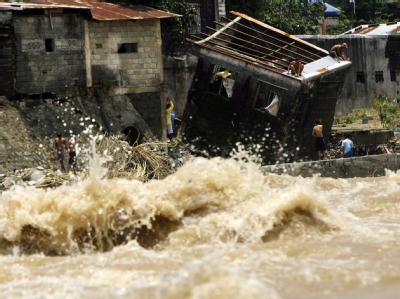 Die Zahl der Toten nach der Flutkatastrophe auf den Philippinen steigt. Foto: Francis R. Malasig