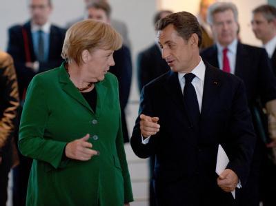 Berlin und Paris tun sich bei der Euro-Rettung schwer. Kanzlerin Angela Merkel und Frankreichs Präsident Nicolas Sarkozy. Archivfoto: Jörg Carstensen