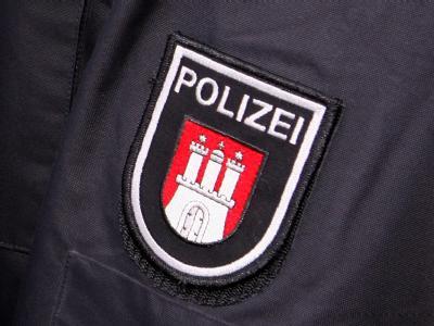 Das Wappen der Hamburger Polizei. In der Hansestadt sind fünf Polizeibeamte brutal überfallen worden.