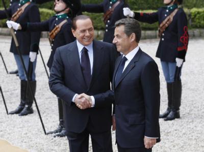 Italiens Regierungschef Berlusconi (l) und Frankreichs Staatspräsident Sarkozy wollen in Extremfällen wieder die Grenzen innerhalb der EU kontrollieren.