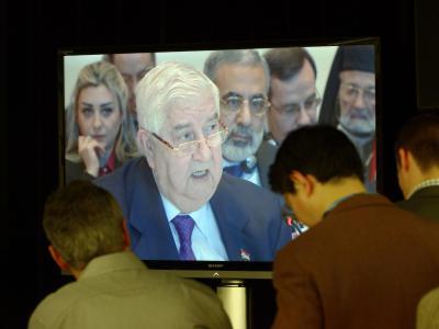 Journalisten verfolgen die Rede des syrischen Außenministers Walid al-Muallim bei der Syrien-Friedenskonferenz. Foto: Rainer Jensen