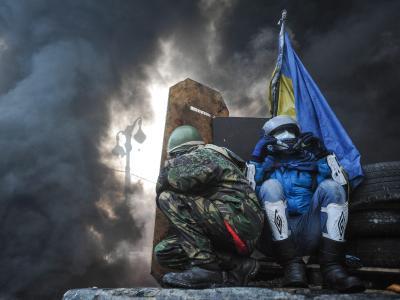 Regierungsgegner auf einer Barrikade in Kiew.Foto: Alexey Furman