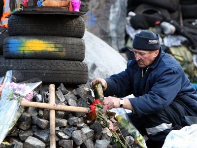 Trauer um die Todesopfer: Schrecken und Chaos herrschen in Kiew nach beispiellosen Straßenschlachten. Foto: Igor Kovalenko