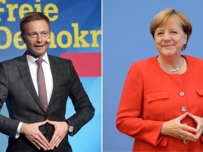 Der FDP-Bundesvorsitzenden Christian Lindner imitiert eine Geste der Bundeskanzlerin Angela Merkel (CDU). Foto: Tobias Hase;Michael Kappeler/Archiv