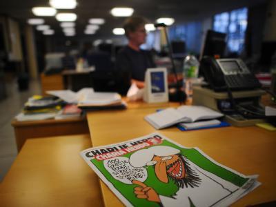 Im November veröffentlichte «Charlie Hebdo» ein Scharia-Sonderheft. Foto: Martin Bureau / Archiv