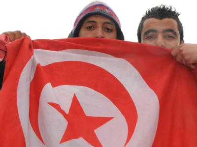 Tunesier mit Flagge
